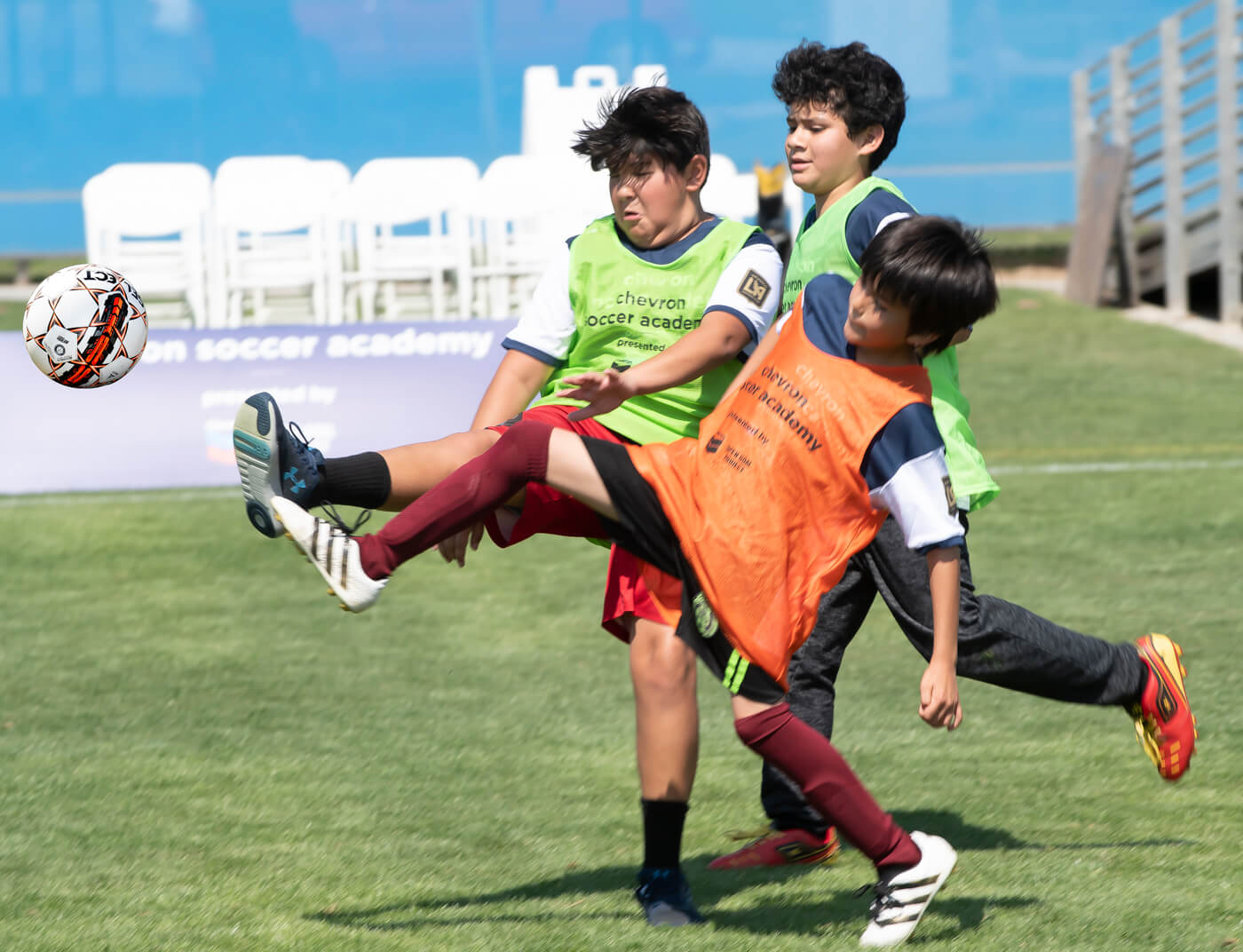 Commercial event photography captures sports at soccer camp event.